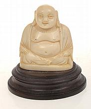 SMALL CARVED IVORY FIGURE OF BUDDHA INCLUDING WOODEN BASE, 6.5CM TALL