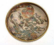 JAPANESE SATSUMA BOWL WITH DECORATIVE INTERNAL MOUNTAIN SCENE AND EXTERNAL FLORAL GARLAND, YASUDA TRADEMARK, 4CM HIGH, 10.5 DIA