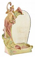 AN ART NOUVEAU FIGURAL BISQUE PORCELAIN TABLE MIRROR