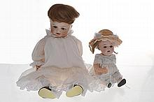 TWO NIPPON BISQUE HEAD DOLLS