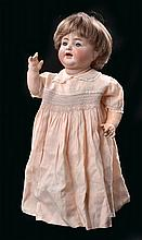 A GERMAN BISQUE HEAD CHARACTER DOLL