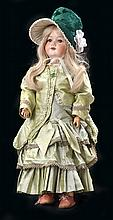 AN ARMAND MARSEILLE AM 390 BISQUE HEAD DOLL WITH JOINTED COMPOSITION
