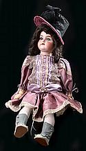 A LARGE SIMON AND HALBIG BISQUE HEAD CHARACTER DOLL BALL JOINTED BODY