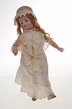 A FRENCH BISQUE HEAD GIRL DOLL WITH MECHANICAL â€aeKISS THROWINGâ€? MECHANISM COMPOSITION BODY