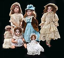 A COLLECTION OF SIX BISQUE HEAD DOLLS