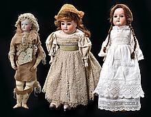 A GROUP OF THREE GERMAN BISQUE HEAD KID BODY DOLLS