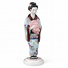 A SOVIET PORCELAIN FIGURINE OF A JAPANESE GIRL WITH FLOWERS -   RUSSIAN, AFTER A MODEL BY NATALIA DANKO, SCULPTED BY ANATOLY LUKIN, STATE PORCELAIN MANUFACTORY, CIRCA 1923