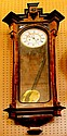 A 19th century Vienna wall clock with walnut and