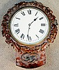 *A Victorian and later carved cased wall clock