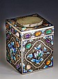A Chinese silver, enamel, gemstone and jade tea caddy 20th century, of square form with gilt interior,
