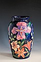 A Moorcroft vase Tigris design by Rachel Bishop, the large ovoid vessel decorated with tropical flowerheads in shades of pink,