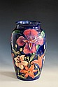 A large Moorcroft vase Tigris design by Rachel Bishop, the large ovoid vessel decorated with tropical flowerheads in shades of pink,