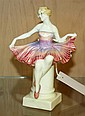 A Royal Doulton HN1296 Columbine figure depicting a girl seated on a pedestal in a pink and mauve dress,