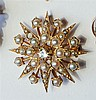 A yellow gold, diamond and seed pearl star pendant brooch