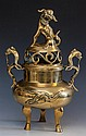 A Chinese polished bronze Koro and cover the flattened circular body decorated with a dragon and phoenix in high relief,