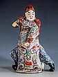 A Chinese famille rose figure of a warrior 20th century, in elaborate ceremonial dress,