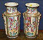 A pair of Chinese Canton famille rose vases 19th century, each with waisted neck and tapering cylindrical bodies, masked ring handles,
