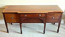 A large George III inlaid mahogany breakfront sideboard with boxwood and ebony stringing and broad satinwood cross banding,