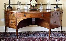 An unusual George III mahogany demi-lune sideboard of impressive proportions,