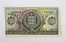An erroneously cut States of Guernsey one pound banknote 1970s, No. C 960540, Hooder signature, cut short to left side,
