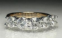 An 18ct yellow and white gold five stone diamond ring