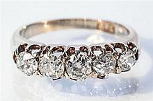 An 18ct yellow gold and diamond five stone ring the five old cut diamonds weighing approx. 0.70 carats, ring size N.