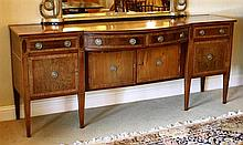 A George III break bow fronted mahogany sideboard of imposing proportions,