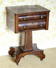 An American mahogany square work table mid-19th century, with two long convex fronted drawers,