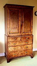A good George I feather-banded figured and burr walnut cabinet on chest circa 1715,