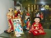 8 PC LOT INCLUDING BOX WITH GEISHA DOLL ORNAMENTS, DOLLS & PICTURE FRAME