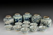 A SET OF PROVINCIAL KILN UNDERGLAZED BLUE AND WHITE BOWLS AND FLASKS