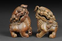 A PAIR OF BAMBOO ROOT GUARDIAN LIONS CARVING