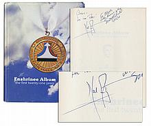 Neil Armstrong Signs a Book on ''The National Aviation Hall of Fame'' -- Into Which He Was Enshrined in 1979
