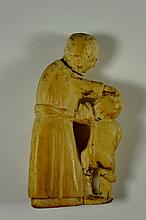 A carved ivory figure of mother and child, 10 cm high, possibly late 17th Century