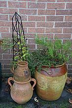 Four terracotta pots, various sizes