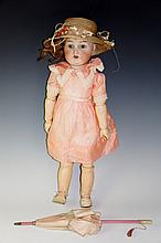 A Simon Halbig / Kammer & Reinhardt character doll fully jointed with flip back eyes, the head impressed K & R and Simon Halbig and numbered 403, 48 cm high overall, Circa 1910