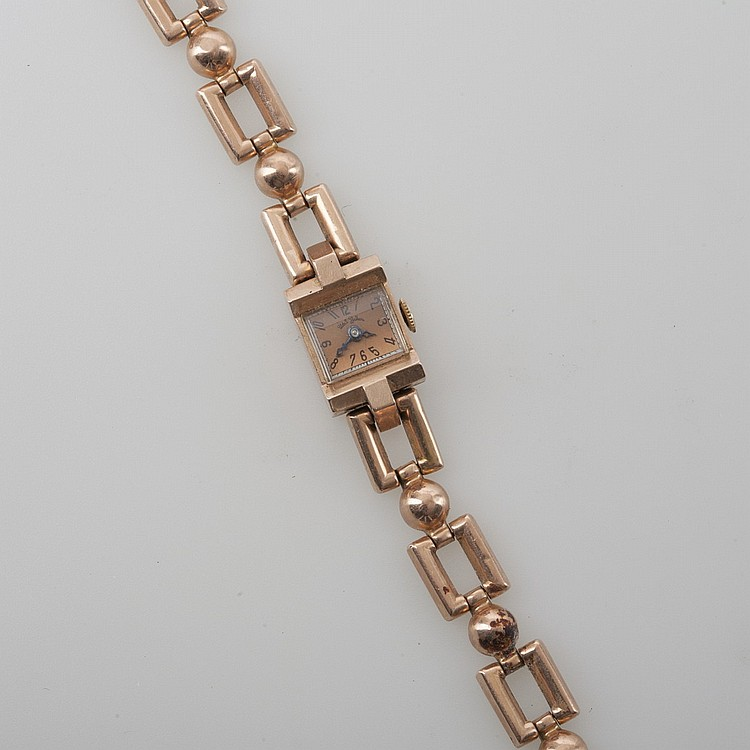 LADY'S TWO-COLOR 14K GOLD WATCH BY UDALL & BALLOU.