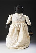 LARGE AMERICAN FOLK ART CLOTH DOLL OF A BLACK WOMAN IN FANCY WHITE DRESS HOLDING A DRAWSTRING PURSE, LATE NINETEENTH CENTURY.