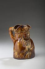 BENNINGTON ROCKINGHAM-GLAZED 'BEN FRANKLIN' TOBY PITCHER WITH BOOT HANDLE, 1849-58.