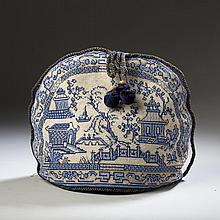 ENGLISH BEADED BERLIN WORK BLUE AND WHITE CHINOISERIE TEA COZY, THIRD QUARTER NINETEENTH CENTURY.