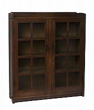 ARTS & CRAFTS OAK SIXTEEN-PANE MODEL #717 BOOKCASE, GUSTAV STICKLEY, EASTWOOD, NEW YORK, 1905-12.