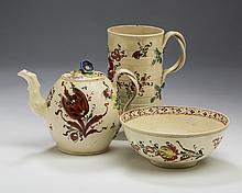 THREE ENGLISH CREAMWARE ENAMEL-DECORATED WARES, CIRCA 1780-1800.