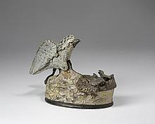 EAGLE AND EAGLETS PAINTED CAST-IRON MECHANICAL BANK, J. & E. STEVENS CO., CROMWELL, CONNECTICUT, PATENTED 1883.