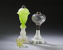 BOSTON & SANDWICH GLASS COMPANY OPAQUE LIME GREEN AND CLAMBROTH 'PRESSED ACANTHUS LEAF' WHALE OIL LAMP, 1850-60; AND A COLORLESS AND OPAQUE WHITE PRESSED 'SHIELD AND STAR' FLUID LAMP, CIRCA 1870.