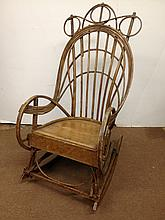 BENTWOOD ADIRONDACK ROCKER, OF WHIMSICAL BOW-BACK FORM AND IN OLD YELLOW PAINT.