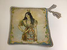 INDIAN MAIDEN PRINTED CLOTH PILLOW WITH BRAID TRIM, EARLY TWENTIETH CENTURY.