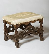 JACOBEAN STYLE CARVED BEECH UPHOLSTERED FOOTSTOOL.