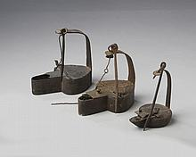 THREE WROUGHT-IRON BETTY LAMPS, LATE EIGHTEENTH-NINETEENTH CENTURY.