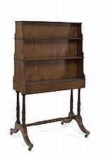 REGENCY WALNUT DOUBLE-SIDED BOOKCASE ON STAND.