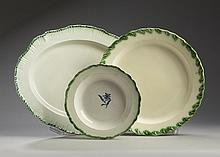 RARE YORKSHIRE CREAMWARE GREEN-GLAZED FOLIATE-EDGE CHARGER, ROTHWELL POTTERY, CIRCA 1770; AND A STAFFORDSHIRE PEARLWARE GREEN SHELL-EDGE PLATTER AND SOUP PLATE, 1780-1800.